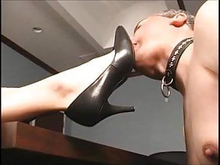 Redhead boss makes him engulf her feet